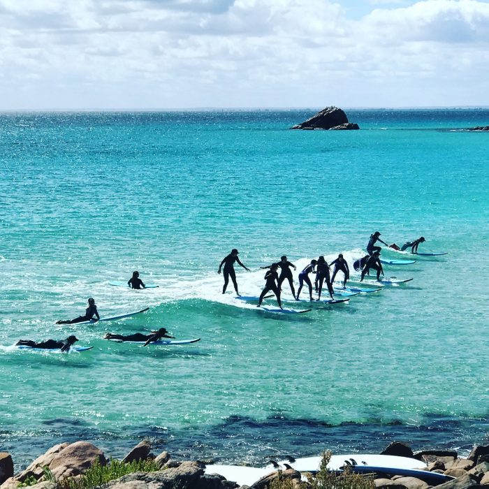 Group of surfer's enjoy a surf holiday