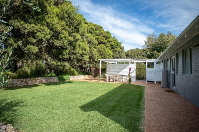 Back garden with spacious lawn area at Surf's Up, Yallingup